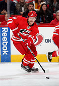 Jiri Tlusty of the Carolina Hurricanes carries the puck during an NHL game against the Vancouver Canucks at PNC Arena on January 16 2015 in Raleigh...