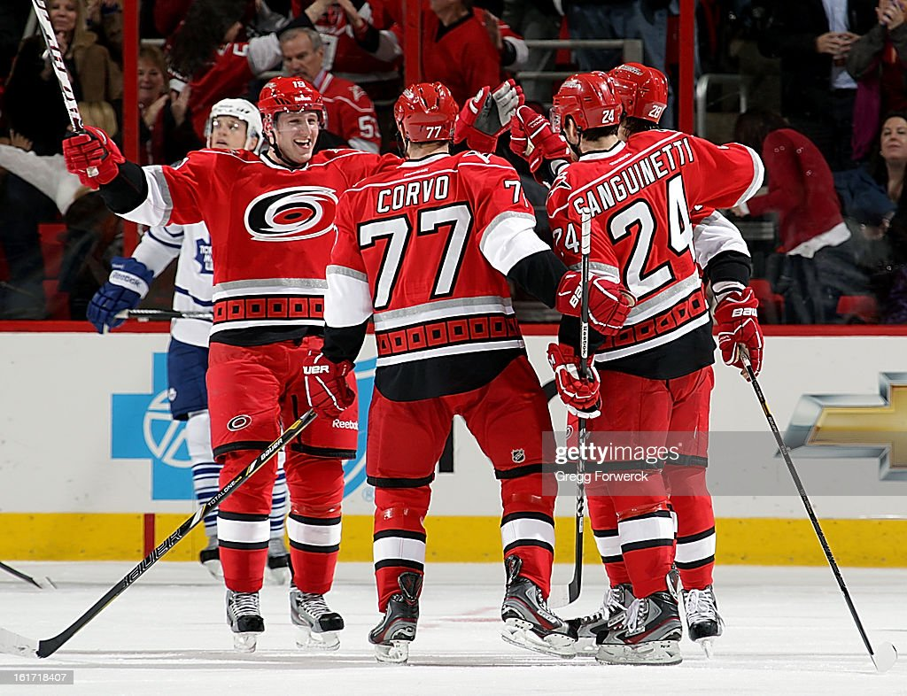 Jiri Tlusty #19 of the Carolina Hurricanes celebrates a goal scored by Joe Corvo #77 during an NHL game against the Toronto Maple Leafs at PNC Arena on February 14, 2013 in Raleigh, North Carolina.