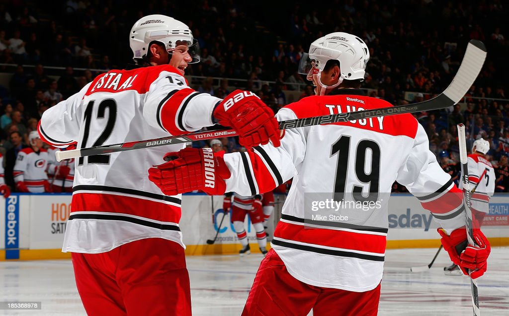 Jiri Tlusty #19 of the Carolina Hurricanes celebrates his 2nd period goal with teammate Eric Staal #12 against the New York Islanders at Nassau Veterans Memorial Coliseum on October 19, 2013 in Uniondale, New York.