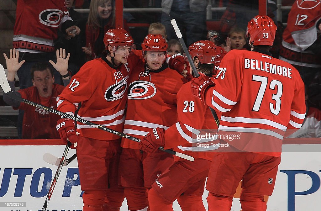 Jiri Tlusty #19 of the Carolina Hurricanes celebrates his second-period goal with teammates Eric Staal #12, Alexander Semin #28 and Brett Bellemore #73 during their NHL game against the Minnesota Wild at PNC Arena on November 9, 2013 in Raleigh, North Carolina.