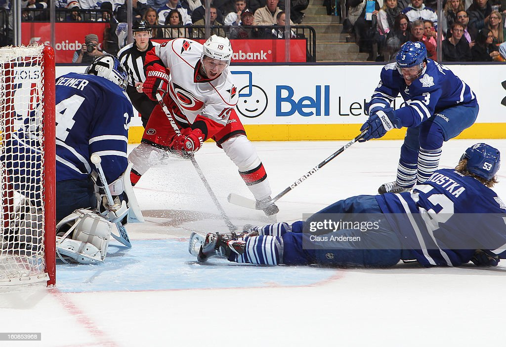Jiri Tlusty #19 of the Carolina Hurricanes has his scoring attempt stopped by James Reimer #34 of the Toronto Maple Leafs in a game on February 4, 2013 at the Air Canada Centre in Toronto, Canada. The Hurricanes defeated the Leafs 4-1.