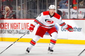 Jiri Tlusty of the Carolina Hurricanes in action against the New Jersey Devils at the Prudential Center on March 8 2014 in Newark New Jersey The...