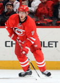 Jiri Tlusty of the Carolina Hurricanes looks to pass the puck during an NHL game against the Montreal Canadiens at PNC Arena on February 8 2014 in...