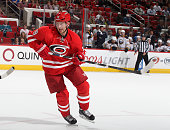 Jiri Tlusty of the Carolina Hurricanes skates for position on the ice during their NHL game against the the Buffalo Sabres at PNC Arena on October 14...