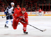 Jiri Tlusty of the Carolina Hurricanes skates for position on the ice during an NHL game against the Winnipeg Jets at PNC Arena on February 4 2014 in...