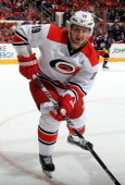 Jiri Tlusty of the Carolina Hurricanes skates for position on the ice during their NHL game against the Columbus Blue Jackets at PNC Arena on March...