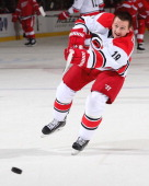 Jiri Tlusty of the Carolina Hurricanes takes a shot in warmups before an NHL game against the Detroit Red Wings at Joe Louis Arena on November 21...