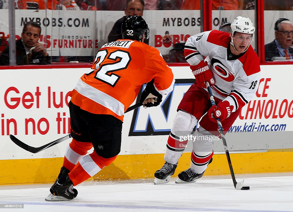 Jiri Tlusty #19 of the Carolina Hurricanes takes the puck as Mark Streit #32 of the Philadelphia Flyers defends at Wells Fargo Center on April 13, 2014 in Philadelphia, Pennsylvania.The Carolina Hurricanes defeated the Philadelphia Flyers 6-5 in an overtime shootout.