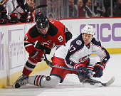 Jiri Tlusty of the New Jersey Devils checks Dalton Prout of the Columbus Blue Jackets at the Prudential Center on October 27 2015 in Newark New Jersey