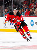 Jiri Tlusty of the New Jersey Devils plays the puck against the San Jose Sharks at the Prudential Center on October 16 2015 in Newark New Jersey