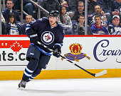 Jiri Tlusty of the Winnipeg Jets keeps an eye on the play during first period action against the St Louis Blues on February 26 2015 at the MTS Centre...