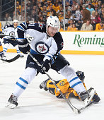 Jiri Tlusty of the Winnipeg Jets protects the puck against a diving Ryan Ellis of the Nashville Predators during an NHL game at Bridgestone Arena on...
