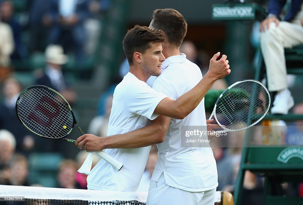 <a gi-track='captionPersonalityLinkClicked' href=/galleries/search?phrase=Jiri+Vesely&family=editorial&specificpeople=6707242 ng-click='$event.stopPropagation()'>Jiri Vesely</a> of Czech Republic is congratulated by <a gi-track='captionPersonalityLinkClicked' href=/galleries/search?phrase=Dominic+Thiem&family=editorial&specificpeople=7026383 ng-click='$event.stopPropagation()'>Dominic Thiem</a> of Austria following his victory during the Men's Singles second round match on day four of the Wimbledon Lawn Tennis Championships at the All England Lawn Tennis and Croquet Club on June 30, 2016 in London, England.