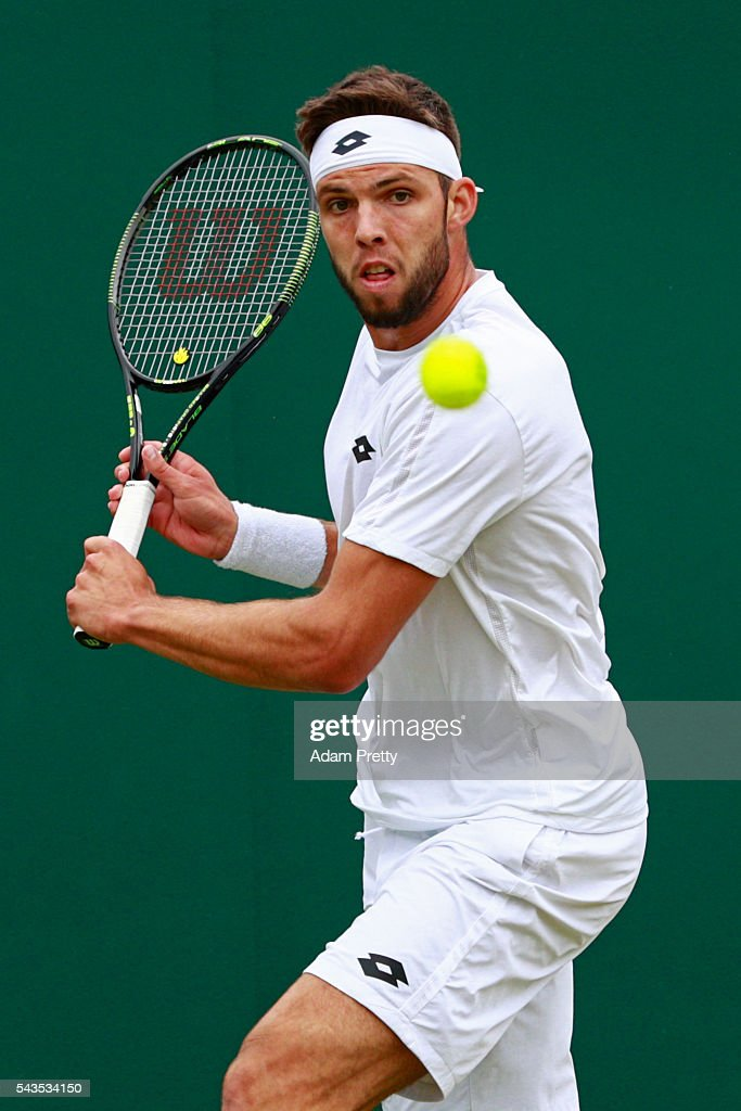 <a gi-track='captionPersonalityLinkClicked' href=/galleries/search?phrase=Jiri+Vesely&family=editorial&specificpeople=6707242 ng-click='$event.stopPropagation()'>Jiri Vesely</a> of Czech Republic plays a backhand during the Men's Singles first round match against Igor Sijsling of Netherlands on day three of the Wimbledon Lawn Tennis Championships at the All England Lawn Tennis and Croquet Club on June 29, 2016 in London, England.