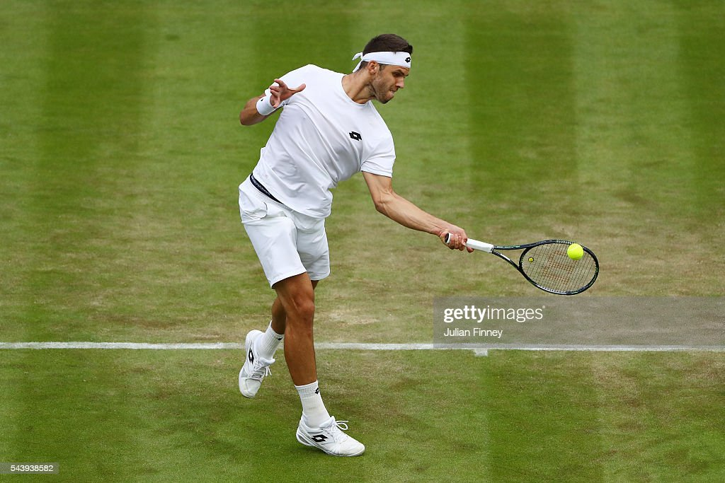<a gi-track='captionPersonalityLinkClicked' href=/galleries/search?phrase=Jiri+Vesely&family=editorial&specificpeople=6707242 ng-click='$event.stopPropagation()'>Jiri Vesely</a> of Czech Republic plays a forehand during the Men's Singles second round match against Dominic Thiem of Austria on day four of the Wimbledon Lawn Tennis Championships at the All England Lawn Tennis and Croquet Club on June 30, 2016 in London, England.