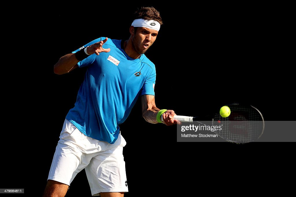 Jiri Vesely of Czech Republic returns a shot to Flippo Volandri of Italy during the Sony Open at the Crandon Park Tennis Center on March 19, 2014 in Key Biscayne, Florida.