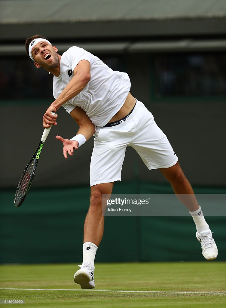 <a gi-track='captionPersonalityLinkClicked' href=/galleries/search?phrase=Jiri+Vesely&family=editorial&specificpeople=6707242 ng-click='$event.stopPropagation()'>Jiri Vesely</a> of Czech Republic serves during the Men's Singles second round match against Dominic Thiem of Austria on day four of the Wimbledon Lawn Tennis Championships at the All England Lawn Tennis and Croquet Club on June 30, 2016 in London, England.
