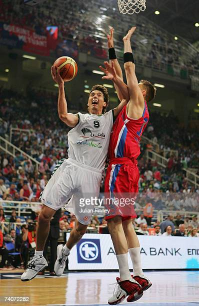 Jiri Welsch of Unicaja jumps to score a basket as David Andersen of CSKA Moscow tries to block during the EuroLeague Final Four Semi Final match...