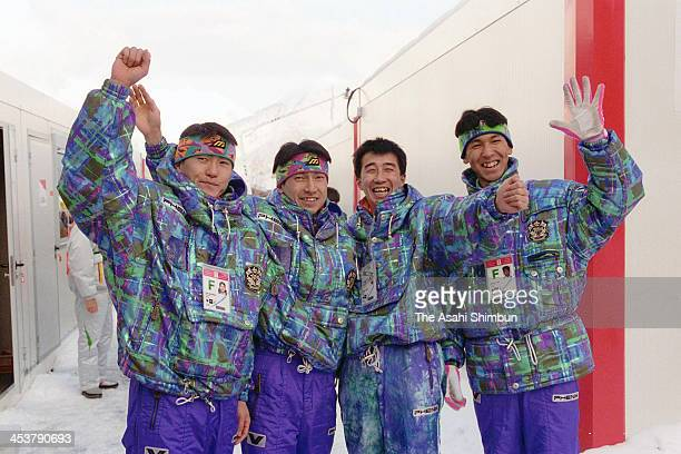 Jiro Kamiharako Kenji Suda Masahiko Harada and Noriaki Kasai of Japan react after the Ski Jumping team competition during the Albertville Olympic on...