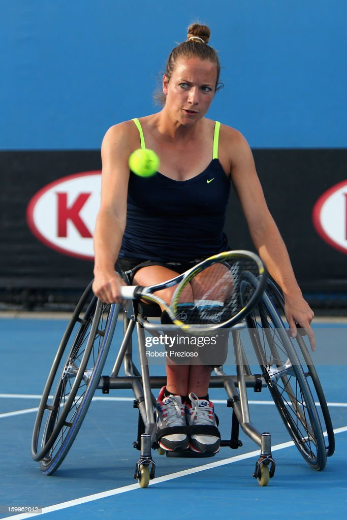 Jiske Griffioen of the Netherlands plays a backhand in her Women's Wheelchair Doubles Semifinal match with Aniek Van Koot of the Netherlands against Kgothatso Montjane of South Africa and Daniela Di Toro of Australia during the 2013 Australian Open Wheelchair Championships at Melbourne Park on January 24, 2013 in Melbourne, Australia.