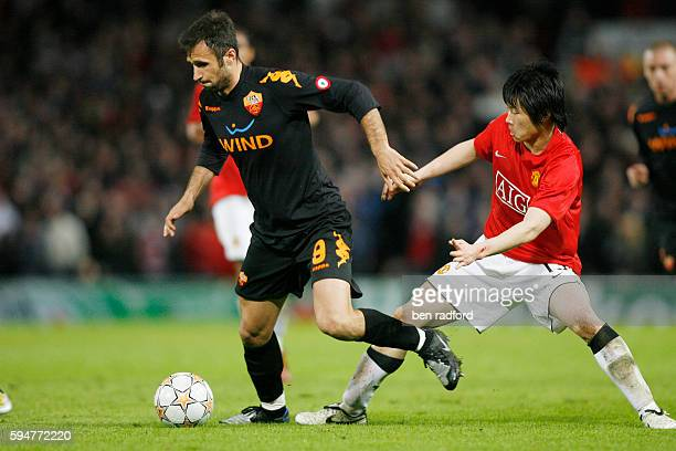 JiSung Park of Manchester United and Mirko Vucinic of Roma during the UEFA Champions League QuarterFinal 2nd leg match between Manchester United and...