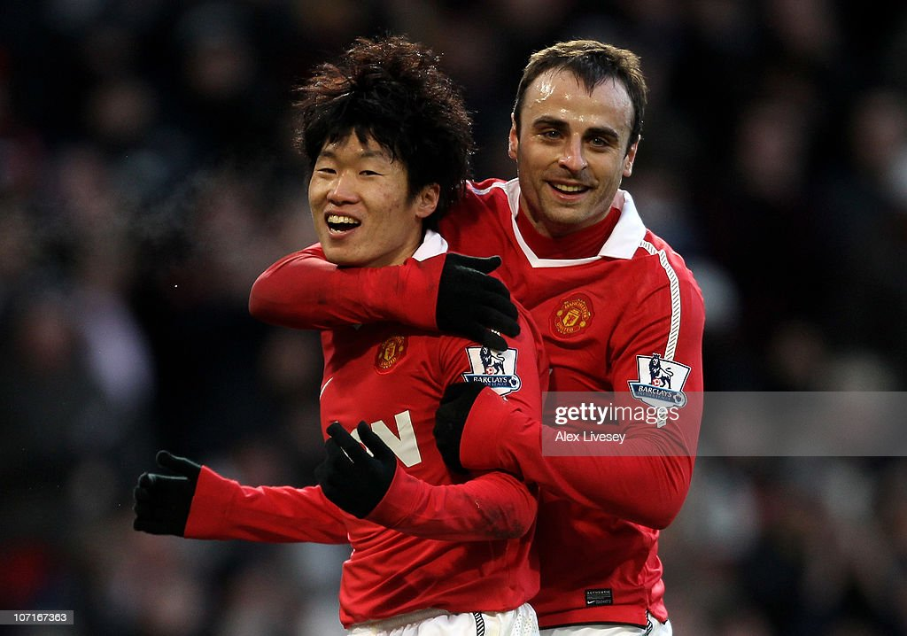 Ji-Sung Park of Manchester United celebrates scoring his team's second goal with team mate <a gi-track='captionPersonalityLinkClicked' href=/galleries/search?phrase=Dimitar+Berbatov&family=editorial&specificpeople=216379 ng-click='$event.stopPropagation()'>Dimitar Berbatov</a> (R) during the Barclays Premier League match between Manchester United and Blackburn Rovers at Old Trafford on November 27, 2010 in Manchester, England.
