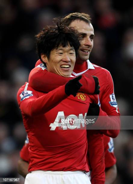 JiSung Park of Manchester United celebrates scoring his team's second goal with team mate Dimitar Berbatov during the Barclays Premier League match...