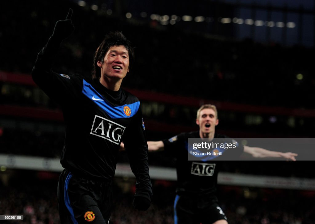 Ji-Sung Park (L) of Manchester United celebrates scoring the third goal of the game during the Barclays Premier League match between Arsenal and Manchester United at The Emirates Stadium on January 31, 2010 in London, England.