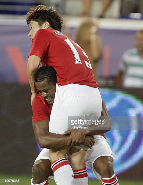 JiSung Park of Manchester United celebrates scoring their second goal during the MLS All Star match between MLS All Stars and Manchester United at...