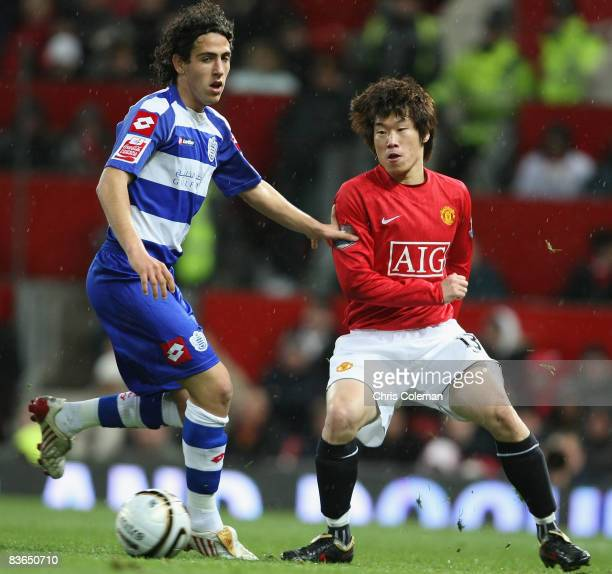 JiSung Park of Manchester United clashes with Daniel Parejo of Queens Park Rangers during the Carling Cup Fourth Round match between Manchester...