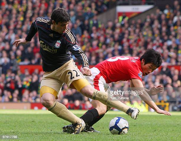 JiSung Park of Manchester United clashes with Emiliano Insua of Liverpool during the FA Barclays Premier League match between Manchester United and...