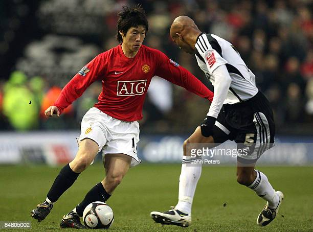 JiSung Park of Manchester United clashes with Jordan Stewart of Derby County during the FA Cup sponsored by eon Fifth Round match between Derby...