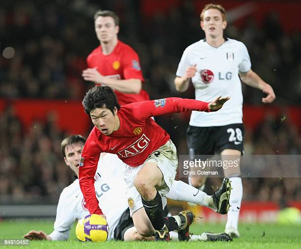 JiSung Park of Manchester United clashes with Toni Kallio of Fulham during the Barclays Premier League match between Manchester United and Fulham at...
