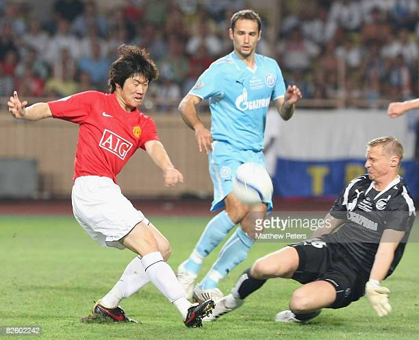 JiSung Park of Manchester United clashes with Vyacheslav Maleev of Zenit St Petersburg during the UEFA Supercup match between Manchester United and...