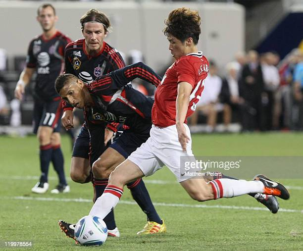 JiSung Park of Manchester United scores their second goal during the MLS All Star match between MLS All Stars and Manchester United at Red Bull Arena...