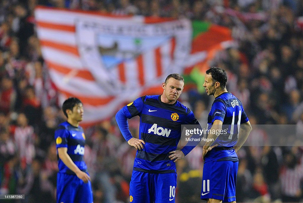 Ji-Sung Park, Wayne Rooney and Ryan Giggs of Manchester United look dejected after conceding a second goal during the UEFA Europa League Round of 16 second leg match between Manchester United and Athletic Bilbao at San Mames Stadium on March 15, 2012 in Bilbao, Spain.