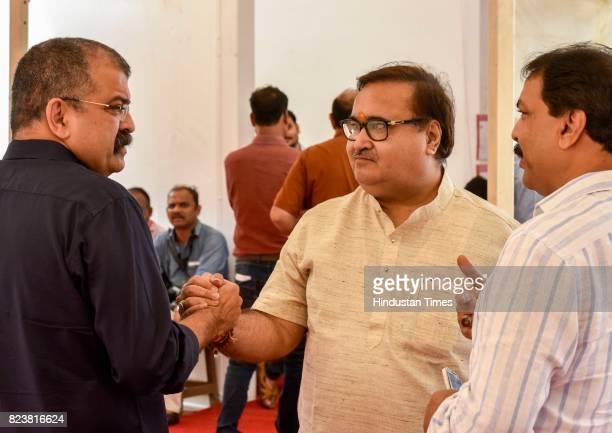 Jitendra Awhad BJP MLA Prakash Mehta and Congress MLA Naseem Khan at Vidhan Bhavan on day 4 of the Monsoon Assembly Session on July 27 2017 in Mumbai...