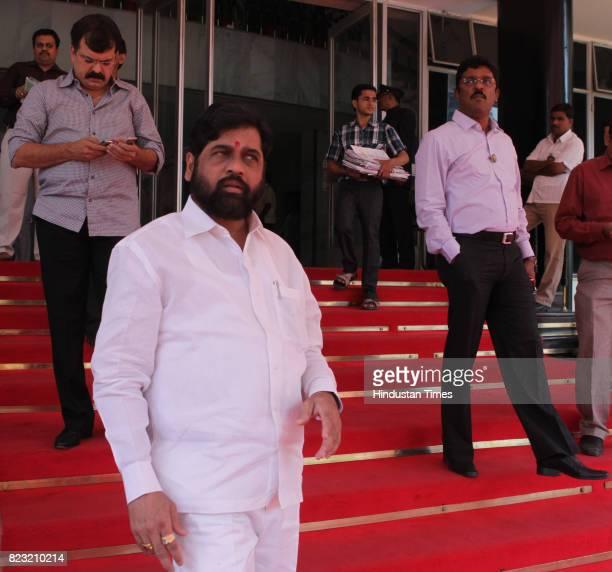 Jitendra Awhad Eknath Shinde and Pratap Sarnaik outside Vidhan Bhavan in Mumbai