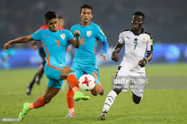 Jitendra Singh Suresh Wangjam of India and Ibrahim Sulley of Ghana battle for the ball during the FIFA U17 World Cup India 2017 group A match between...