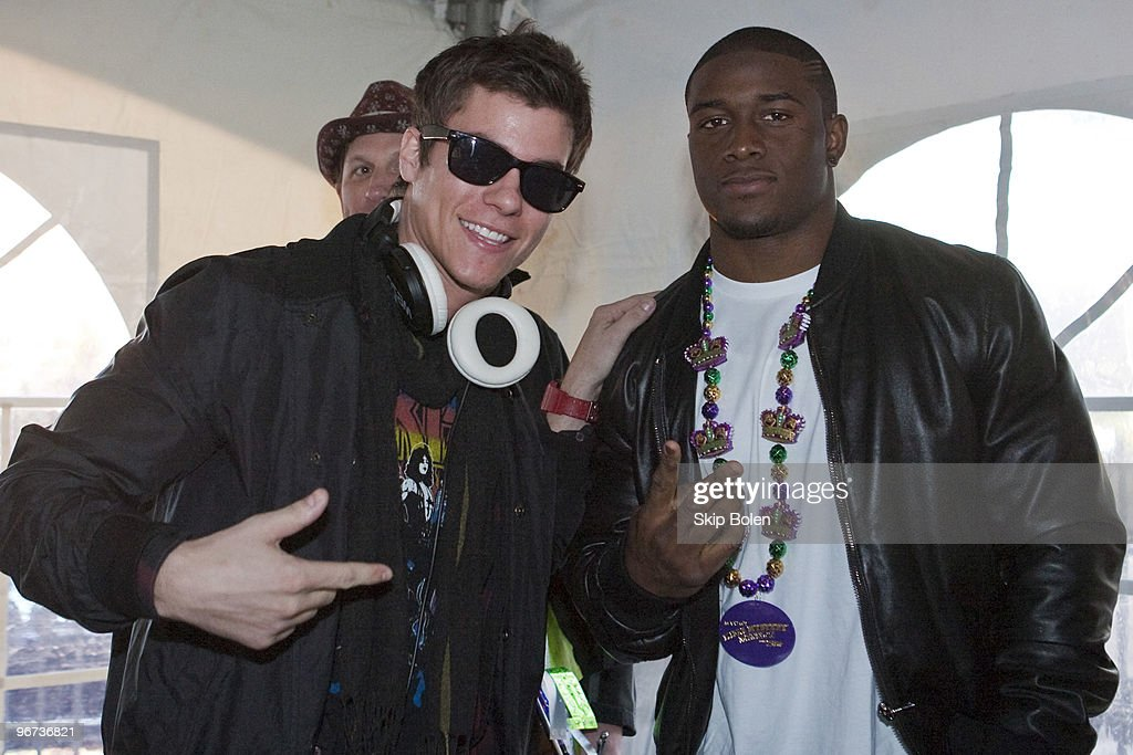 DJ Jive and Super Bowl XLIV winning New Orleans Saints Runningback <a gi-track='captionPersonalityLinkClicked' href=/galleries/search?phrase=Reggie+Bush&family=editorial&specificpeople=183392 ng-click='$event.stopPropagation()'>Reggie Bush</a> #25 attends Maxim's Mega Mansion at Buckner Mansion on February 15, 2010 in New Orleans, Louisiana.
