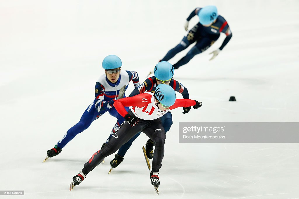 Jiwon Park of South Korea (Silver medal), <a gi-track='captionPersonalityLinkClicked' href=/galleries/search?phrase=Charle+Cournoyer&family=editorial&specificpeople=11622477 ng-click='$event.stopPropagation()'>Charle Cournoyer</a> of Canada (Gold medal) and <a gi-track='captionPersonalityLinkClicked' href=/galleries/search?phrase=Semen+Elistratov&family=editorial&specificpeople=8823657 ng-click='$event.stopPropagation()'>Semen Elistratov</a> of Russia (Bronze medal) cross the finish line in the 1000m Mens Final during ISU Short Track Speed Skating World Cup held at The Sportboulevard on February 14, 2016 in Dordrecht, Netherlands.