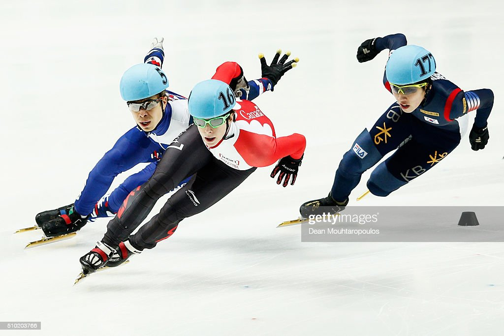 Jiwon Park of South Korea ((R) Silver medal), <a gi-track='captionPersonalityLinkClicked' href=/galleries/search?phrase=Charle+Cournoyer&family=editorial&specificpeople=11622477 ng-click='$event.stopPropagation()'>Charle Cournoyer</a> of Canada ((C) Gold medal) and <a gi-track='captionPersonalityLinkClicked' href=/galleries/search?phrase=Semen+Elistratov&family=editorial&specificpeople=8823657 ng-click='$event.stopPropagation()'>Semen Elistratov</a> of Russia ((L) Bronze medal) sprint to the finish line in the 1000m Mens Final during ISU Short Track Speed Skating World Cup held at The Sportboulevard on February 14, 2016 in Dordrecht, Netherlands.
