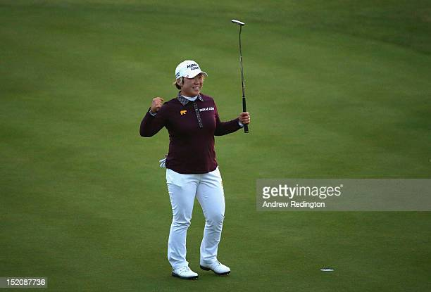 Jiyai Shin of Korea celebrates holing her final putt for victory on the 18th green during the final round of the Ricoh Women's British Open at Royal...