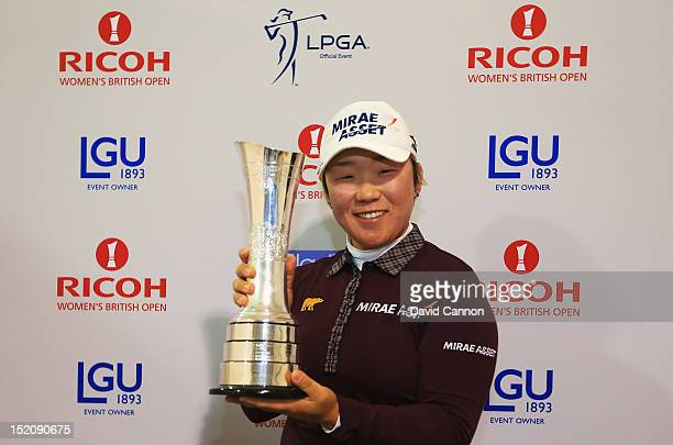 Jiyai Shin of Korea poses with the trophy following her victory during the final round of the Ricoh Women's British Open at Royal Liverpool Golf Club...