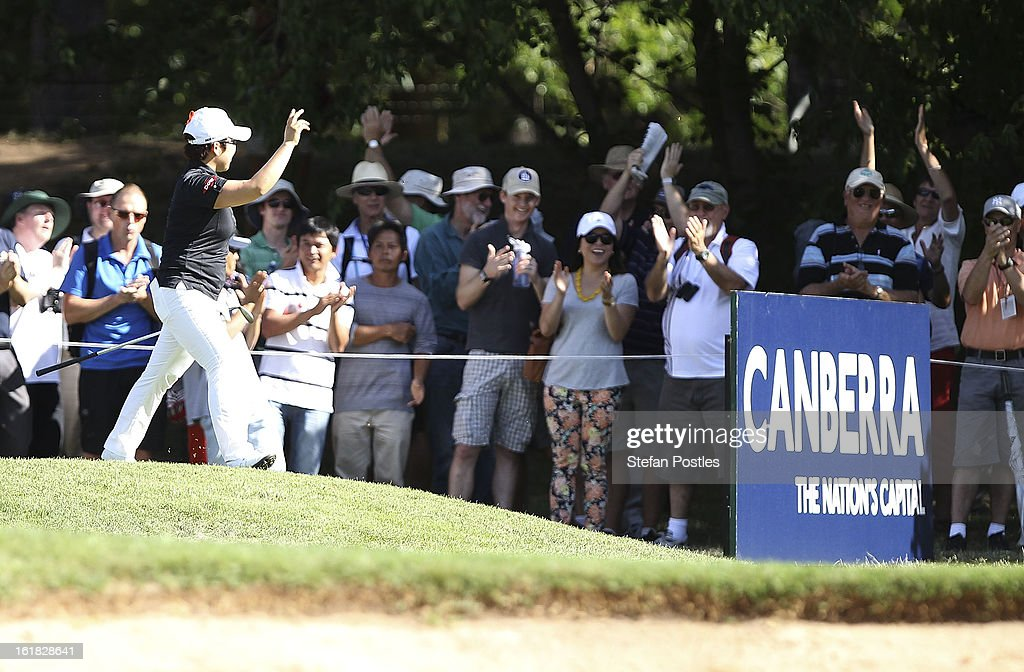 Jiyai Shin of South Korea acknowledges the crowd after sinking a putt on the 14th hole during day four of the ISPS Handa Australian Open at Royal Canberra Golf Club on February 17, 2013 in Canberra, Australia.
