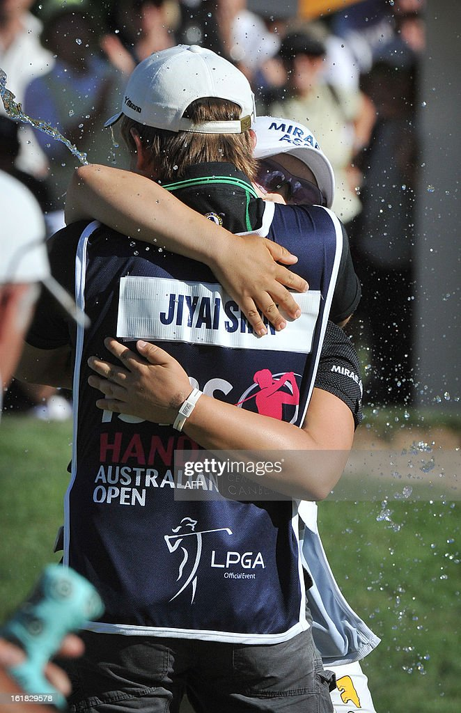 Jiyai Shin of South Korea and her caddy get showered in water after winning the Women's Australian Open golf tournament in Canberra on February 17, 2013.