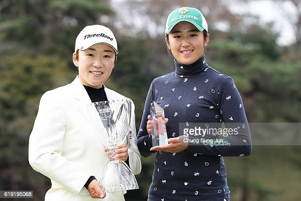 Jiyai Shin of South Korea and Mone Inami pose with the trophy after during a ceremony following the Mitsubishi Electric/Hisako Higuchi Ladies Golf...