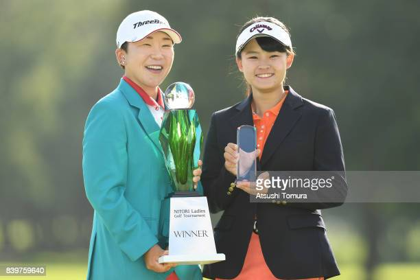Jiyai Shin of South Korea and Yumeno Masada of Japan pose with the trophy after winning the Nitori Ladies 2017 at the Otaru Country Club on August 27...