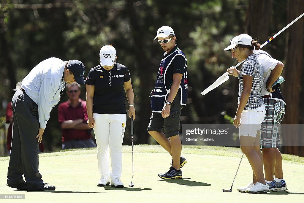 Jiyai Shin of South Korea calls over the official to inspect the green on the 5th hole during day four of the ISPS Handa Australian Open at Royal Canberra Golf Club on February 17, 2013 in Canberra, Australia.