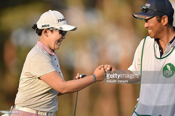 Jiyai Shin of South Korea celebrates after making her birdie putt on the 9th green during the first round of the World Ladies Championship Salonpas...